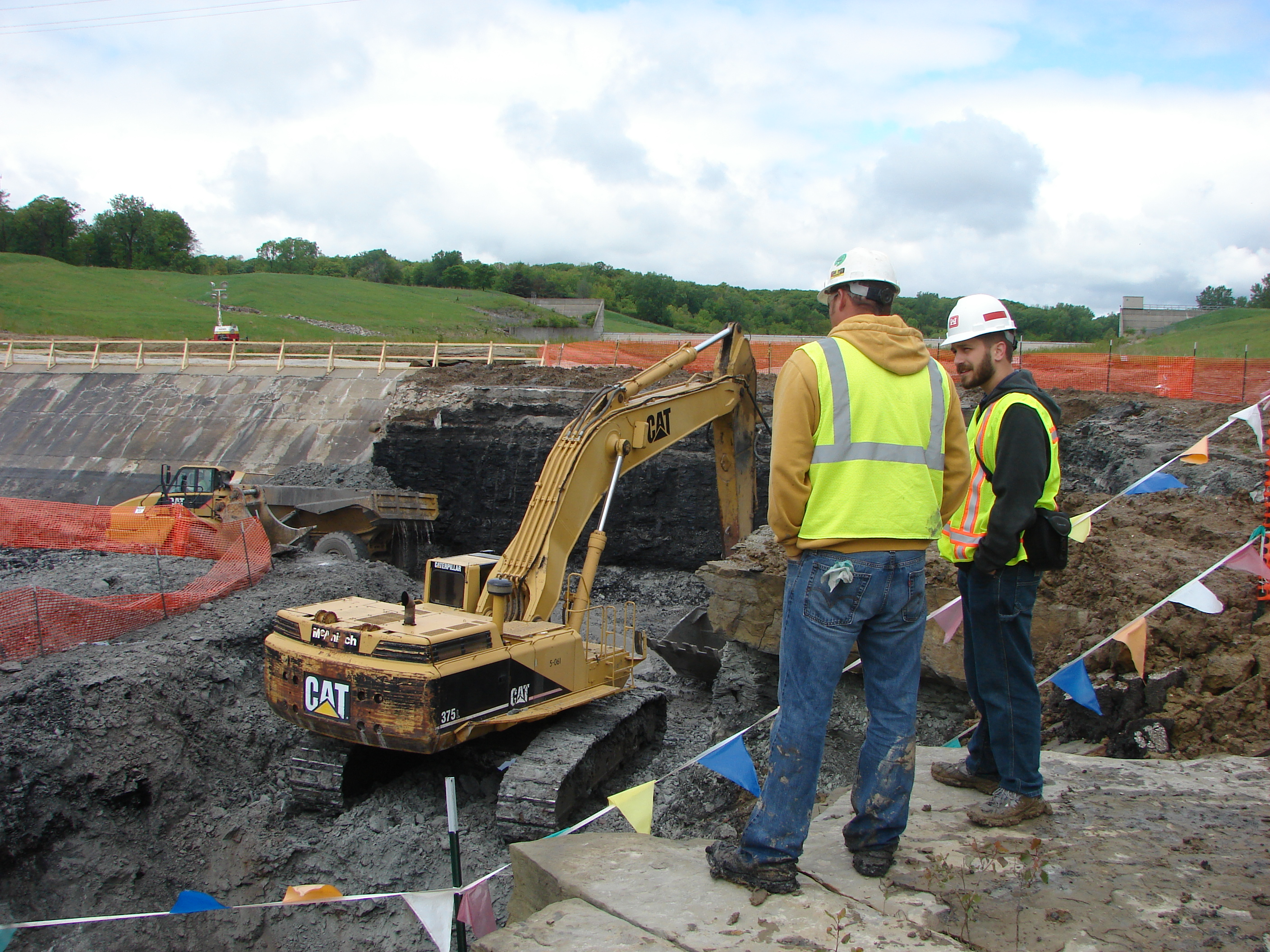 An engineer with the Corps of Engineers talks with a contractor at a construction site at Saylorville Lake.