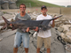 Fishermen with Paddlefish caught below Red Rock Dam